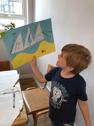 Proud as Punch with his artwork at Children's Art Club